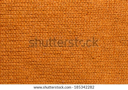 Orange wool knit work. Orange wool knit work full frame for warming winter texture, backdrop or background. - stock photo