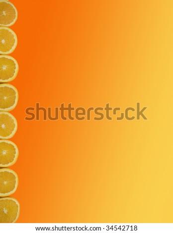 Orange/yellow gradient border/background with a row of fresh orange slices along edge - stock photo