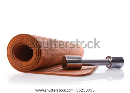 orange yoga mat and dumbbell with reflex - stock photo