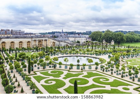 Orangery was designed by Louis Le Vau, it is located south of the Palace Versailles, Paris, France. Versailles was a royal chateau. It was added to the UNESCO list of World Heritage Sites - stock photo