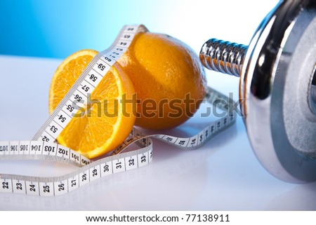 oranges and a part of dumbell - stock photo