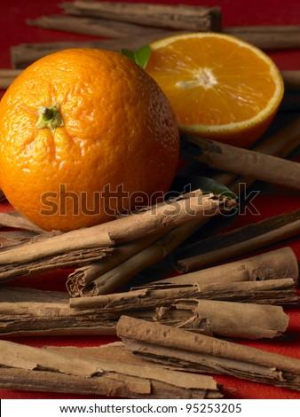 Oranges and Cinnamon Sticks - stock photo