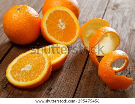 Oranges and dried peel on a rural table