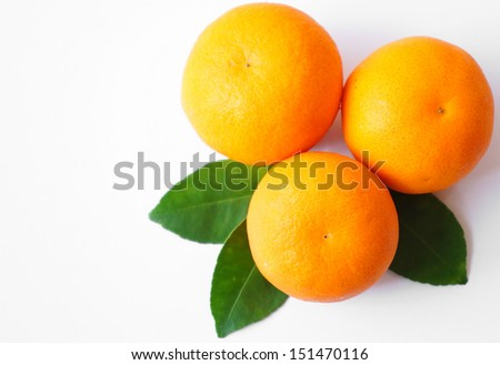 Oranges  and leaf isolated on a white background
