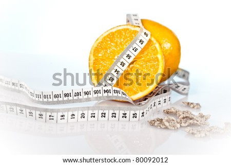 oranges and measure tape - stock photo