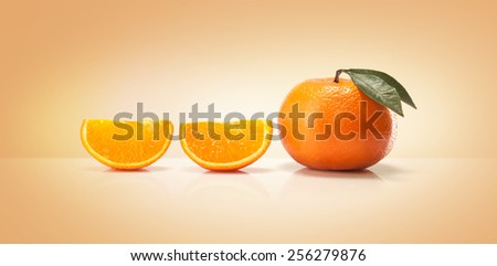 Oranges fruit and orange wedge isolated on a colored background - stock photo