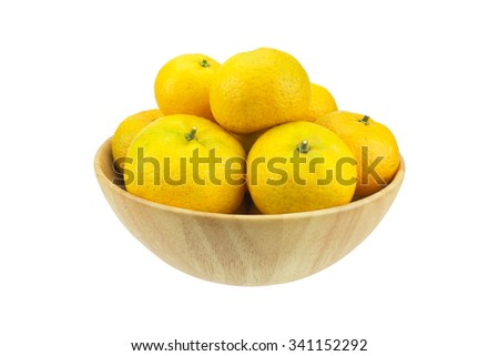 Oranges in wooden bowl on a white background. - stock photo