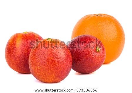 Oranges of different breeds isolated on white background. Focus point - middle orange - stock photo