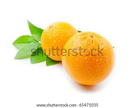 Oranges with leaves - stock photo