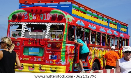 ORANJESTAD, ARUBA - NOV 26: Colorful tour bus in Aruba, as seen on Nov 26, 2015. About three quarters of the Aruban gross national product is earned through tourism or related activities.