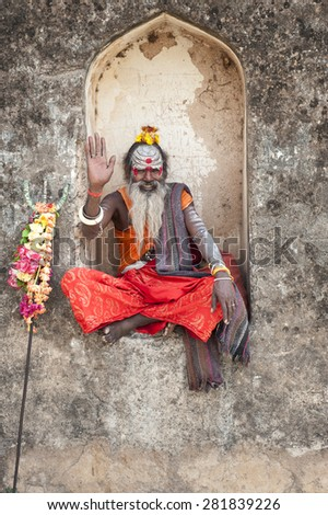 ORCHA,INDIA -  APRIL  24, 2015: A holy Sadhu man with traditional painted face, blessing at  Lakshmi Narayan Temple in Orchha, Madhya Pradesh, India. April 24, 2015  - stock photo
