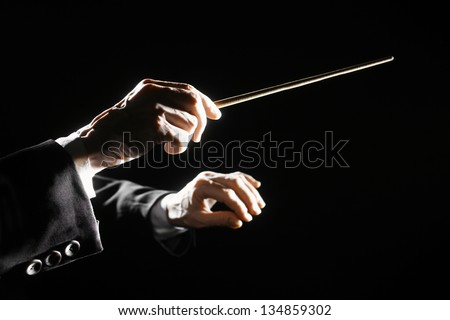 Orchestra conductor hands baton. Music director holding stick