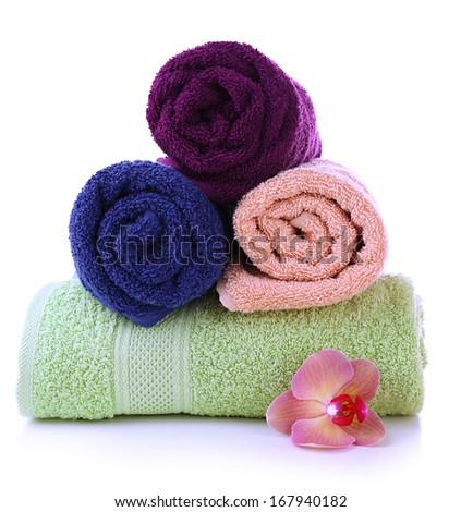 Orchid flower and towel rolls, isolated on white