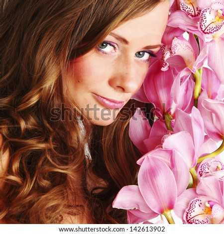 orchid woman flower in hairs - stock photo