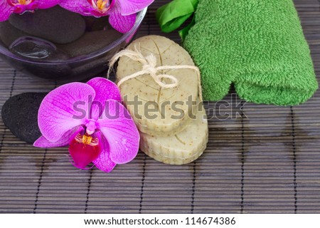 orchids  and spa settings on bamboo mat - stock photo