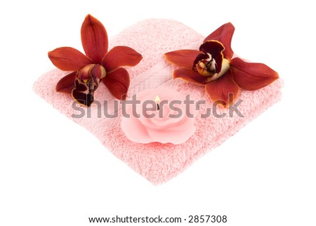Orchids, pink towel and candle - stock photo