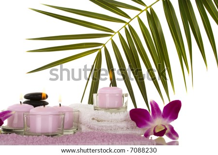 Orchids, towel, candles, pebbles and aromatic bath salt in a spa - stock photo
