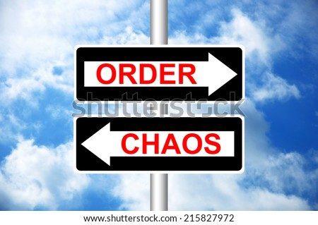 Order Or Chaos Road Signs with a blue sky in a background - stock photo