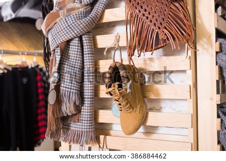 Ordinary apparel store with different clothes on hangers