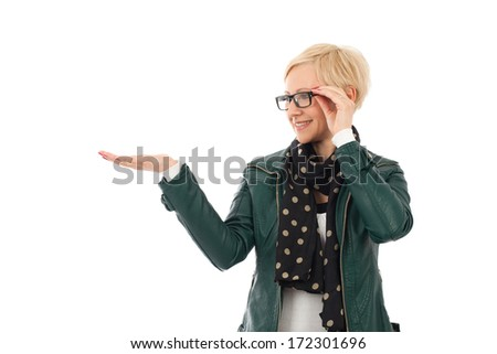 Ordinary young woman in casual outfit holding empty palm with copyspace - stock photo
