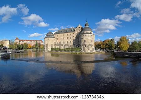 Orebro Castle in autumn sunny day, Sweden - stock photo