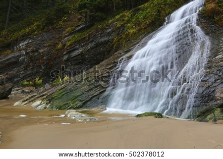 Oregon beach waterfall