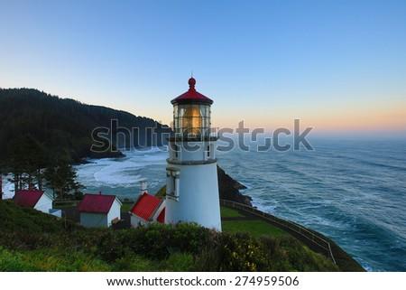 Oregon coast lighthouse and sunrise - stock photo