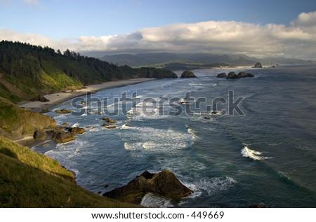 Oregon coastline near Cannon Beach - Haystack Rock in the distance - stock photo