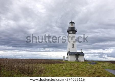 Oregon lighthouse in Newport, Oregon. - stock photo