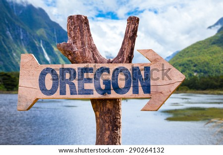 Oregon wooden sign with mountains background - stock photo