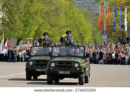 Orel, Russia - May 09, 2015: Celebration of the 70th anniversary of the Victory Day (WWII). Military officers standing in cars during parade