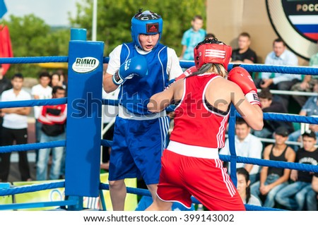 ORENBURG, ORENBURG region, RUSSIA - 25 July 2014: Model boxing match between girls from Russia and Kazakhstan. The match was held at the youth meeting Wednesday between Russia and Cuba