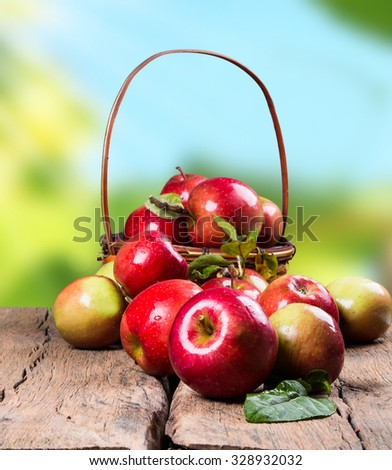 Organic Apples in a Basket on wooden background