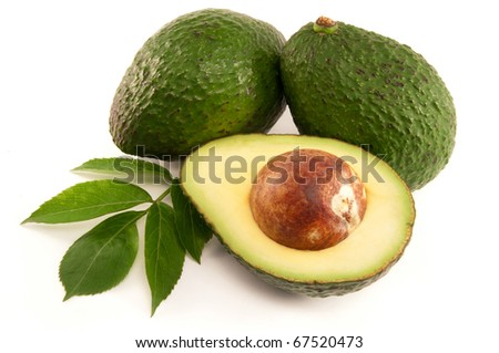 Organic Avocado, opened and whole on white background
