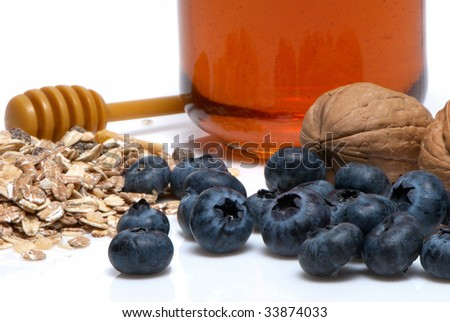 Organic blueberries And other dietary products on a light background - stock photo