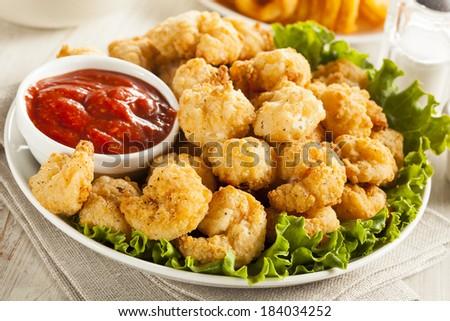 Organic Breaded Popcorn Shrimp with Cocktail Sauce - stock photo