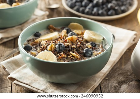 Organic Breakfast Quinoa with Nuts Milk and Berries - stock photo