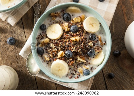 Organic Breakfast Quinoa with Nuts Milk and Berries - stock photo