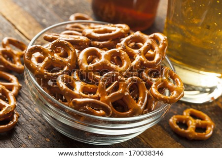 Organic Brown Mini Pretzels with Salt and a Beer - stock photo