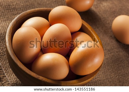Organic Cage Free Brown Eggs on a background