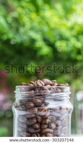 Organic coffee beans transparent bottle - stock photo