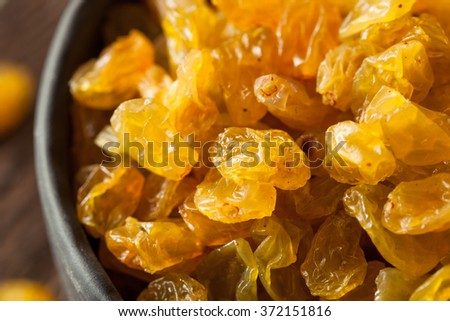 Organic Dried Golden Raisins in a Bowl - stock photo