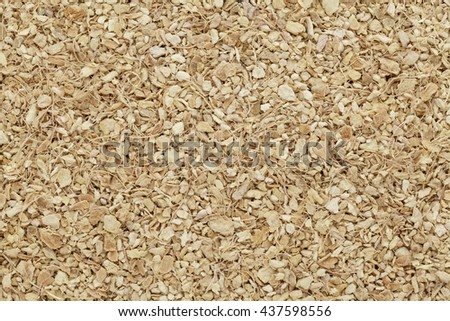 Organic dry Ginger (Zingiber officinale). Macro close up background texture. Top view. - stock photo