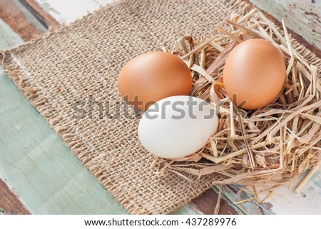 Organic Eggs On Vintage Wooden Background.