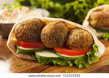 Organic Falafel in a Pita Pocket with Tomato and Cucumber - stock photo