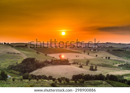 Organic farming in hill -?? sunset on lush vineyards and farmland in the quiet hilly countryside - stock photo