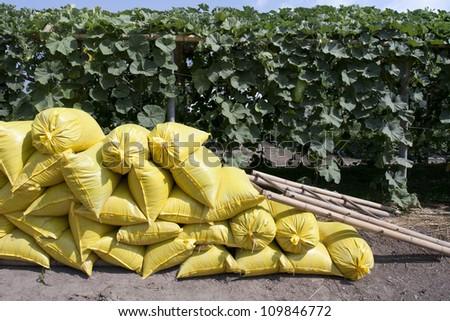 Organic fertilizer bag in garden - stock photo