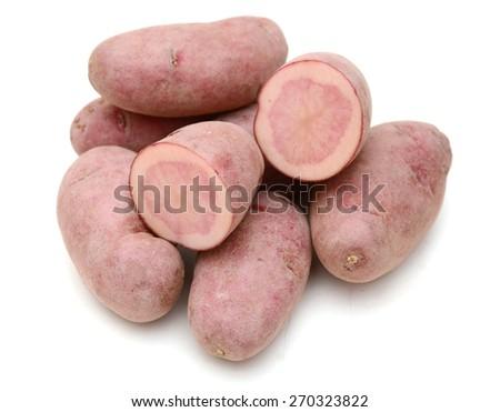 organic fingerling potatoes on white background  - stock photo