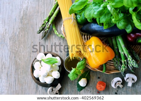 organic food ingredients ,cooking concept ,on wooden background with space for text or logo - stock photo