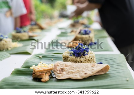 organic food served with banana leaf on an outdoor party
